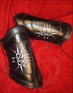 Adjustable Leather Bracers with Demon Skull Design